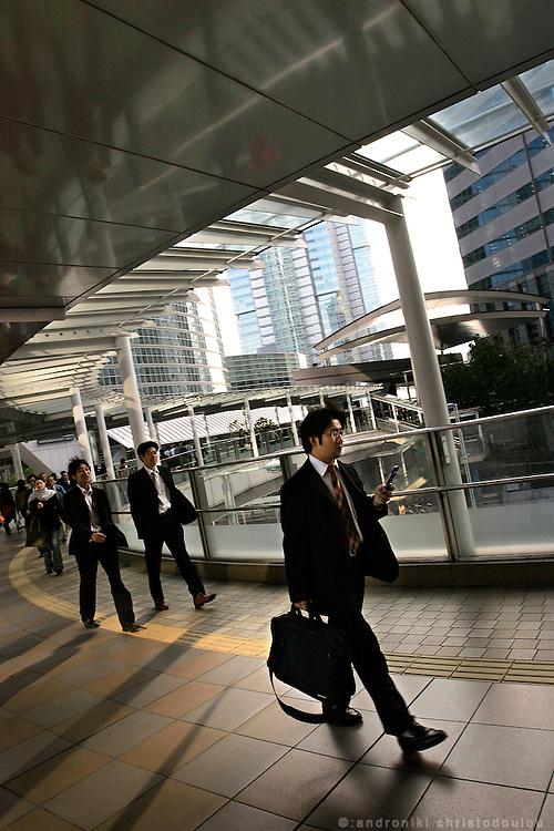 Office employees (salarymen) during lunch time break in Shinagawa. Tokyo