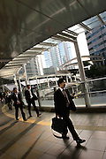 Office employees (salarymen) during lunch time break in Shinagawa. Tokyo