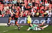 Lions v Highlanders. Courtnall Skosan of the Emirates Lions escapes the tackle of Matt Faddes of the Highlanders during the 2016 Super Rugby semi-final match at Ellis Park, Johannesburg, 30 July 2016. <br /> <br /> © Anton de Villiers / www.photosport.nz