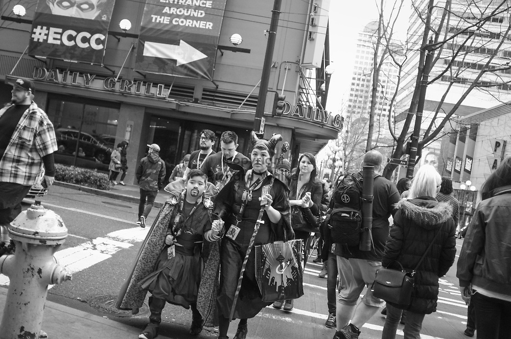 2017 MARCH 05 - People at the corner of 7th and Pine Street near Emerald City Comicon, downtown, Seattle, WA, USA. By Richard Walker