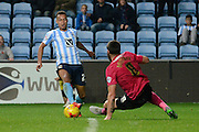 Peterborough United midfielder Michael Bostwick dives in to tackle Coventry City midfielder Jacob Murphy during the Sky Bet League 1 match between Coventry City and Peterborough United at the Ricoh Arena, Coventry, England on 31 October 2015. Photo by Alan Franklin.