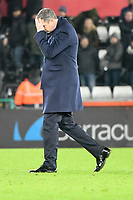 Football - 2017 / 2018 Premier League - Swansea City vs. West Bromwich Albion<br /> <br /> Swansea City manager Paul Clement holds his head as he walks of the pitch after Swansea win , at The Liberty Stadium.<br /> <br /> COLORSPORT/WINSTON BYNORTH