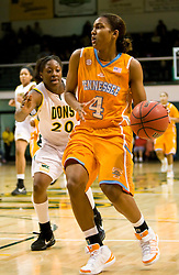 December 22, 2009; San Francisco, CA, USA;  Tennessee Lady Volunteers guard Kamiko Williams (4) is guarded by San Francisco Dons forward Donnisha Taylor (20) during the second half at War Memorial Gym.  Tennessee defeated San Francisco 89-34.
