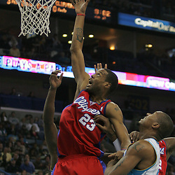 Jan 13, 2010; New Orleans, LA, USA; Los Angeles Clippers forward Marcus Camby (23) tips in the ball for a score over New Orleans Hornets forward David West (30) during the second quarter at the New Orleans Arena. Mandatory Credit: Derick E. Hingle-US PRESSWIRE