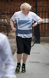 © Licensed to London News Pictures. 12/06/2017. London, UK. Foreign Secretary Boris Johnson checks the time on his watch as he takes an early morning run in Westminster London. Over the weekend British prime minister Theresa May formed a new cabinet and continues discussions with the DUP in an attempt to form a new government. Photo credit: Peter Macdiarmid/LNP