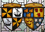 Stained glass window depicting coats of arms, detail, in James IV's Great Hall, 1503-13, the chief assembly hall in the castle, on Crown Square, in Edinburgh Castle on Castle Rock, Edinburgh, Scotland. The Great Hall was used as a military barracks in the 17th and 18th centuries and as a military hospital in the 19th century, then restored by Hippolyte Blanc, 1844-1917, to medieval style. The first royal castle built here was under David I in the 12th century, and the site has been built on, attacked and defended ever since. The castle now houses military museums and the National War Museum of Scotland and is run by Historic Scotland. Picture by Manuel Cohen