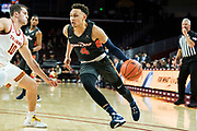 Pepperdine Waves guard Colbey Ross (4) attempts to drive past Southern California Trojans guard Quinton Adlesh (10) during an NCAA college basketball game, Tuesday, Nov. 19, 2019, in Los Angeles. USC defeated Pepperdine 91-84. (Jon Endow/Image of Sport)
