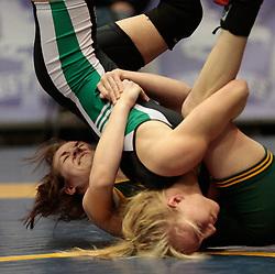 London, Ontario ---2013-03-02---    Jasmine Slinn of  University Of Regina takes on  Natasha Kramble  of  U Of Sask in the women's 48 KG bronze medal match at the 2012 CIS Wrestling Championships in London, Ontario, March 02, 2013. .GEOFF ROBINS/Mundo Sport Images