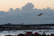 Juliana Airport. Air France Airbus 340 starting at sunset.