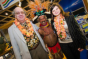 ITB (Internationale Tourismusbörse) 2005, World's largest tourism fair..Visitors taking souvenir photos with a gentleman from Papua New Guinea.