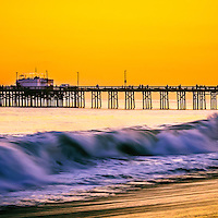 Orange County panoramic sunset picture. Balboa Pier is in Newport Beach on Balboa Peninsula  along the Pacific Ocean in Orange County Southern California. The pier is a popular attraction for fishing and the Ruby's Diner restaurant at the end of the pier. Panorama ratio is 1:3.