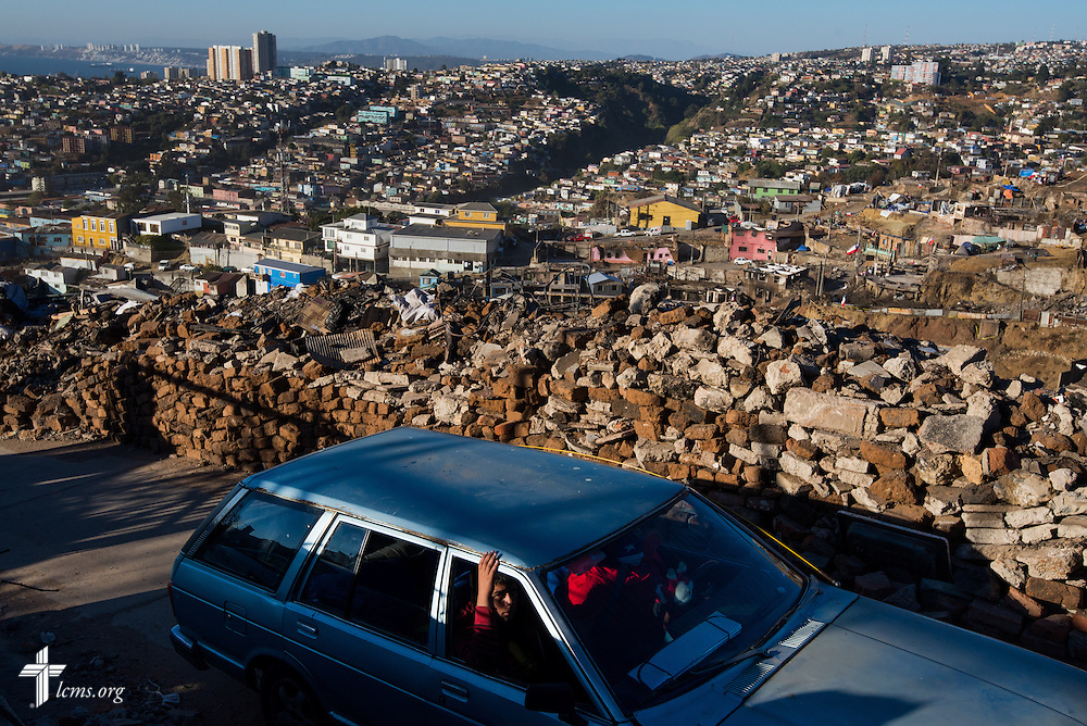 A driver navigates a narrow pathway on Monday, April 21, 2014, toward a hillside of homes affected by a devastating fire in Valparaíso, Chile. The catastrophic fire that tore through the hillsides above the historic port city fire killed 15 people, destroyed about 3000 homes, and left approximately 15,000 people homeless.  LCMS Communications/Erik M. Lunsford