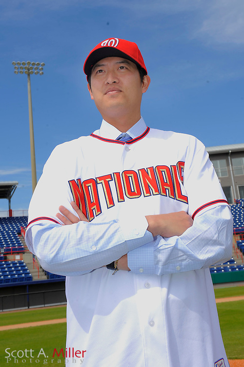 Chien-Ming Wang of Taiwan is introduced at a press conference after the pitcher signed a one-year $2 million contract the Washington Nationals in Viera, Florida, February 19, 2010..©2010 Scott A. Miller..