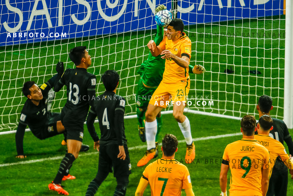 MELBOURNE, AUSTRALIA - SEPTEMBER 5 : Tomas Rogic of the Australia Socceroos heads the ball as Sinthaweechai Hathairattanakool of Thailand punches the ball away during the Stage 3 Group World Cup Football Qualifiers between Australia Vs Thailand at the Melbourne Rectangular Stadium, Melbourne, Australia 5 September 2017.