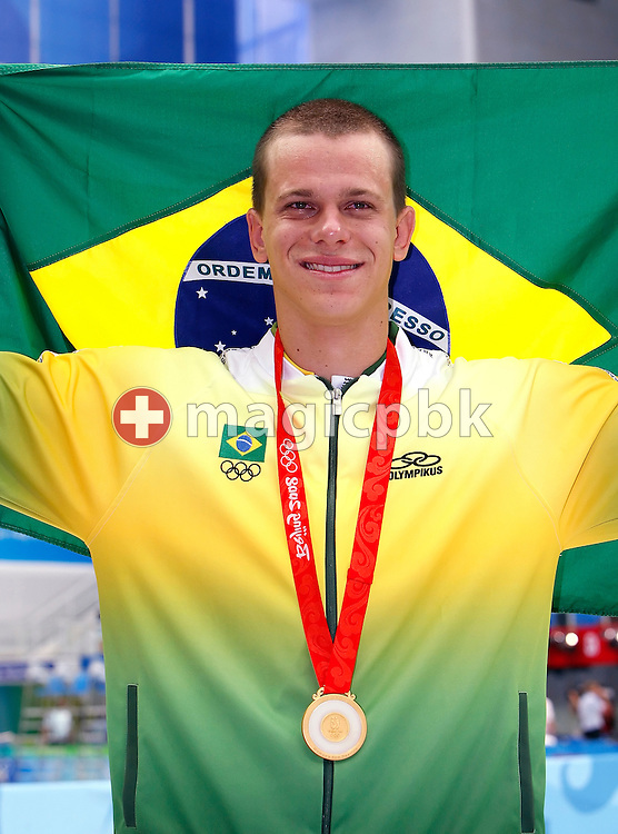 Cesar CIELO FILHO of Brazil poses with his Gold medal after winning Brazil's first swimming Olympic Gold medal after finishing first in the Men's 50m Freestyle Final held at the National Aquatics Center (Water Cube) at the Beijing 2008 Olympic Games in Beijing, China, Saturday, Aug. 16, 2008. (Photo by Patrick B. Kraemer / MAGICPBK)