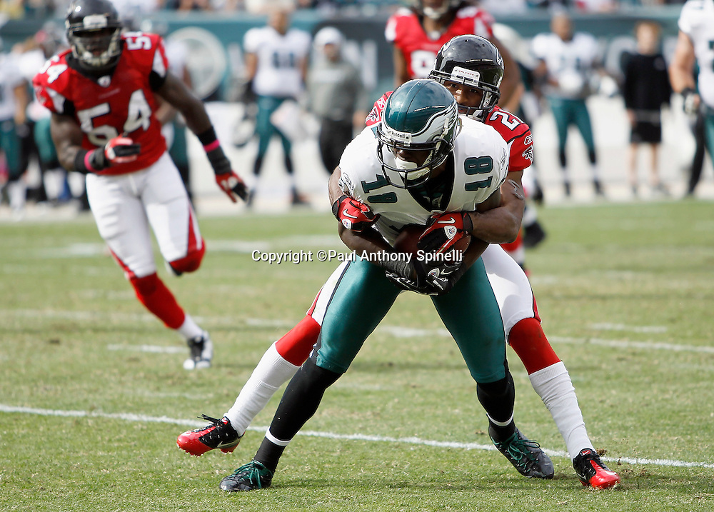 Philadelphia Eagles wide receiver Jeremy Maclin (18) catches a pass and gets tackled by Atlanta Falcons cornerback Christopher Owens (21) during the NFL week 6 football game against the Atlanta Falcons on Sunday, October 17, 2010 in Philadelphia, Pennsylvania. The Eagles won the game 31-17. (©Paul Anthony Spinelli)