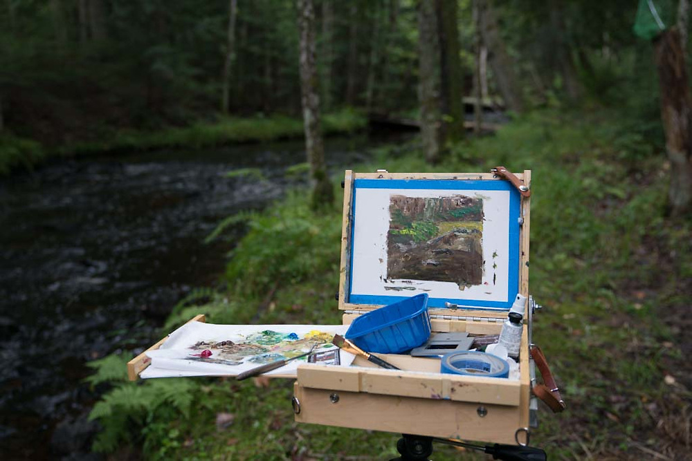 Plein air painters practice their craft painting outdoors in the natural beauty of Michigan's Upper Peninsula near Marquette, Michigan.