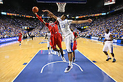 Kentucky forward Anthony Davis, right, contests a shot by Mississippi forward Aaron Jones in the second half. UK hosted Ole Miss Saturday, Feb. 18, 2012 at Rupp Arena in Lexington . Photo by