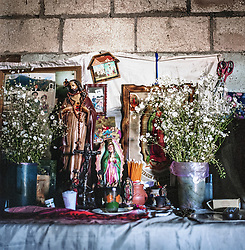 Religious altar in the village of Pampojila. For many of Guatemalas poor, parts of the Church have become one of the few organizations that actually work for their interests. Radical clerics take their side in the struggle for fertile land, partly as negotiators towards large farms and in some cases; priests have even donated land themselves.