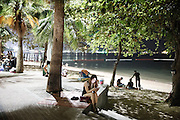 Evening by the sea along the main road in central Pattaya district where a lot of prostitutes can be seen  by the beach.&nbsp;<br />Both prostitutes and sex tourists can be seen hanging around the boardwalk of Pattaya Beach as night falls.<br /><br />&copy; Giulio Di Sturco<br />Pattay, Thailand 2016
