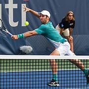 BRADLEY KLAHN hits a volley at the Rock Creek Tennis Center.