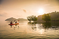 St Johns Island, Mergui Archipelago, Myanmar, April 2016.  Guests of the Manaia Project explore the mangrove forest by kayak. Project Manaia researches the Mergui Archipelago, Myanmar to help protect this remote island group for future generations and keep it as pristine as it is now. Manaia aims to provide a platform for independent scientists as well as camera teams to get them on the location for documentation and scientific work on Climate change issues, ocean acidification, plastic gyres and others. Photo by Frits Meyst / MeystPhoto.com