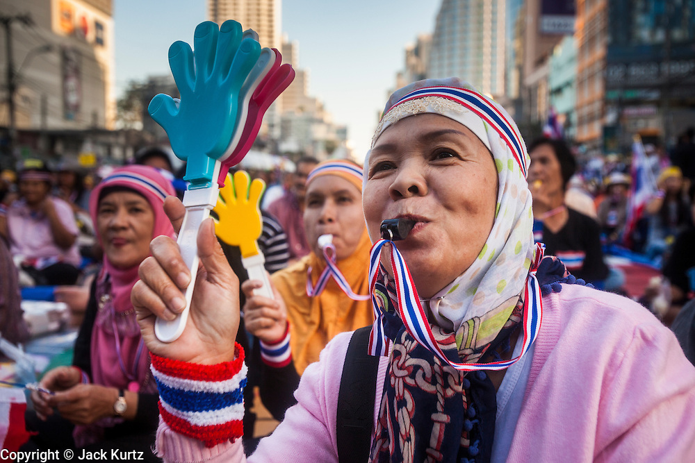 """13 JANUARY 2014 - BANGKOK, THAILAND: Thai Muslims, members of the anti-government protest movement, at a rally in the Asoke intersection in Bangkok. Tens of thousands of Thai anti-government protestors took to the streets of Bangkok Monday to shut down the Thai capitol. The protest was called """"Shutdown Bangkok"""" and is expected to last at least a week. The Shutdown Bangkok protest is a continuation of protests that started in early November. There have been shootings almost every night at different protests sites around Bangkok, including two Sunday night, but the protests Monday were peaceful. The malls in Bangkok stayed open Monday but many other businesses closed for the day and mass transit was swamped with both protestors and people who had to use mass transit because the roads were blocked.    PHOTO BY JACK KURTZ"""