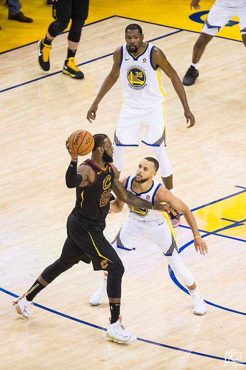Golden State Warriors guard Stephen Curry (30) defends Cleveland Cavaliers forward LeBron James (23) during Game 1 of the NBA Finals at Oracle Arena in Oakland, Calif., on May 31, 2018. (Stan Olszewski/Special to S.F. Examiner)