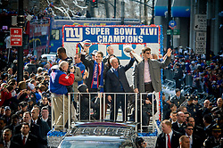 Tue Feb 07, 2012: New York City Parade for Super Bowl champion NY Giants. Float 5 - seen here - held Justin Tuck, Eli Manning, Mayor Bloomberg and Governor Cuomo, amongst other dignitaries..Credit: Rob Bennett for The Wall Street Journal  Slug: PARADE