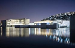 Exterior evening view of the Louvre Abu Dhabi at Saadiyat Island Cultural District in Abu Dhabi, UAE. Architect Jean Nouvel