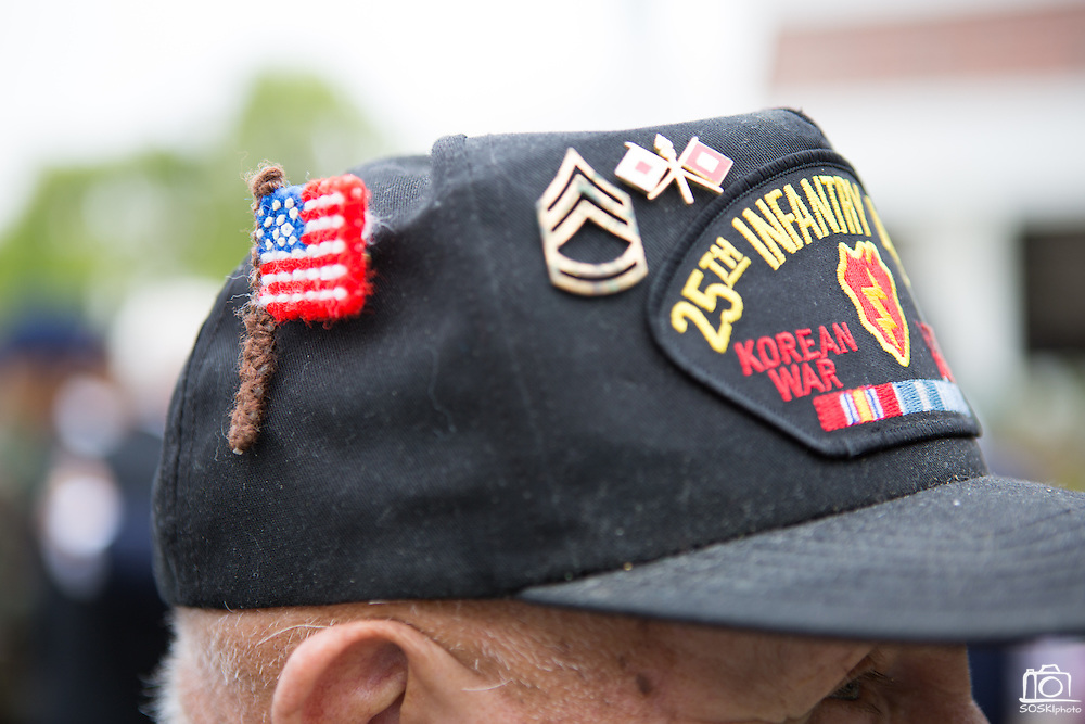 Ed Hart, United States Army veteran of the Korean War (1953-1954), wears a baseball cap decorated with pins and patches during the Milpitas Memorial Day Ceremony at Veterans Memorial Flag Plaza in Milpitas, California, on May 27, 2013. (Stan Olszewski/SOSKIphoto)