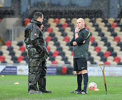 Referee Charles Breakspear looks to the sky as he decides whether the FA Cup tie between Newport County and Blackburn Rovers should be played - Mandatory by-line: Paul Knight/JMP - Mobile: 07966 386802 - 09/01/2016 -  FOOTBALL - Rodney Parade - Newport, Wales -  Newport County v Blackburn Rovers - FA Cup third round