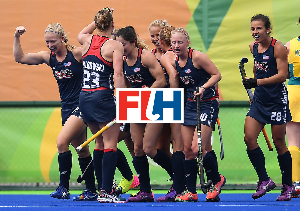The USA's Stefanie Fee (L) celebrates a goal with teammates during the womens's field hockey Australia vs USA match of the Rio 2016 Olympics Games at the Olympic Hockey Centre in Rio de Janeiro on August, 8 2016. / AFP / MANAN VATSYAYANA        (Photo credit should read MANAN VATSYAYANA/AFP/Getty Images)