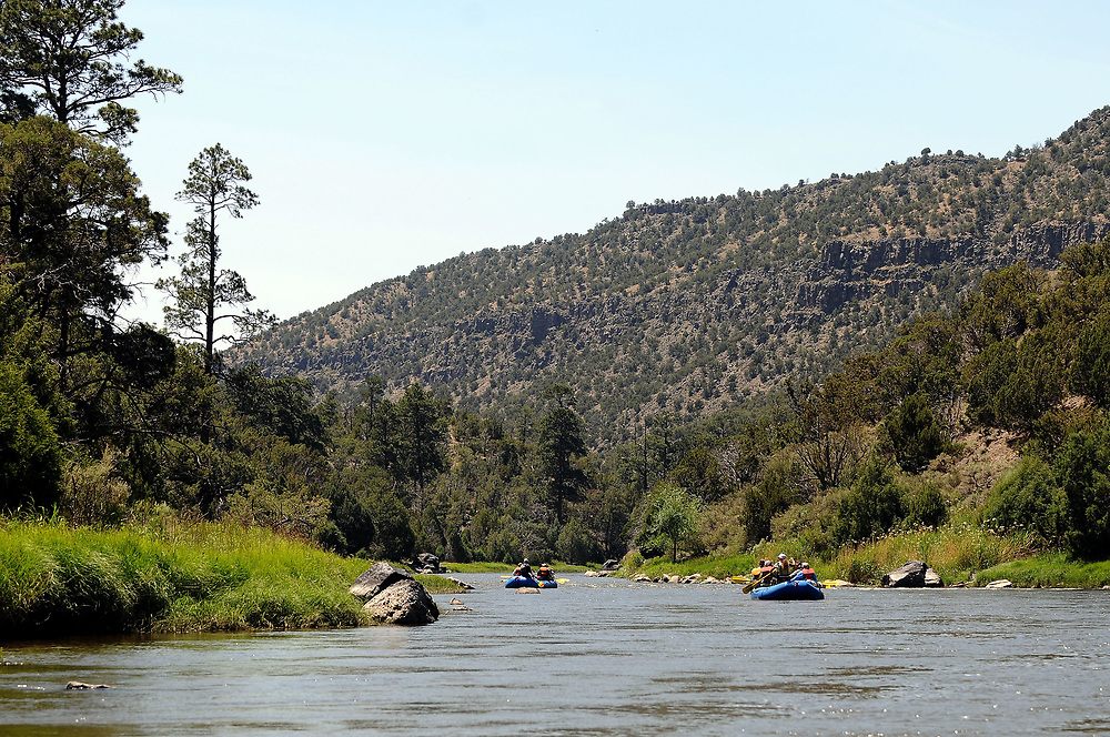 jt062917a/ a sec/jim thompson/ Rafts float down the Middle Box area of the Rio Grande. This is just a small are of the 242,555 acres of the area proposed for the Rio Grande del Norte Nation Monument.Thursday June. 29, 2017. (Jim Thompson/Albuquerque Journal)