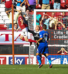 Leicester City's Kasper Schmeichel keeps out Charlton Athletic's Simon Church  - Photo mandatory by-line: Robin White/JMP - Tel: Mobile: 07966 386802 31/08/2013 - SPORT - FOOTBALL - The Valley - Charlton - Charlton Athletic V Leicester City - Sky Bet Championship