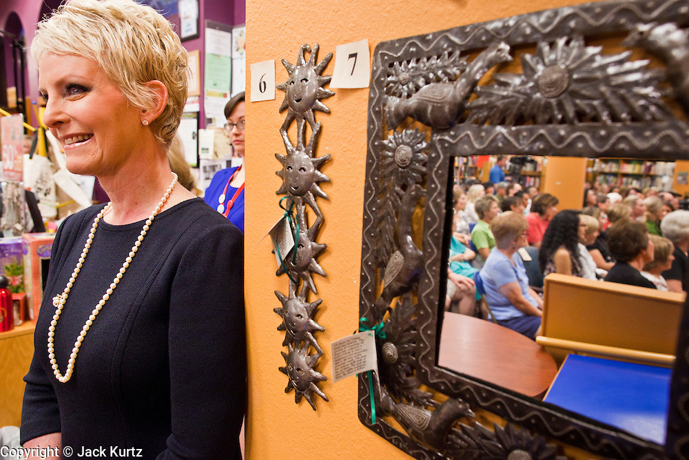 """Sept. 16 - TEMPE, AZ: CINDY MCCAIN, mother of Meghan McCain and wife of US Sen. John McCain (R-AZ) listens to Meghan discuss her book, """"Dirty Sexy Politics"""" during a book signing at Changing Hands Bookstore in Tempe, AZ, Thursday, Sept. 16. McCain's book is a recounting of her life on the campaign trail during the 2008 election, when her father, John McCain, was the Republican candidate for President of the United States.  Photo by Jack Kurtz"""