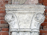 (Detail) architectural feature on the facade of the Doge's Palace in Venice, Italy. The palace was the residence of the Doge of Venice, the supreme authority of the Republic of Venice. Its two most visible façades look towards the Venetian Lagoon and St. Mark's Square, or rather the Piazzetta. The use of arcading in the lower stories produces an interesting 'gravity-defying' effect. There is also effective use of colour contrasts. largely constructed from 1309 to 1424, designed perhaps by Filippo Calendario. It replaced earlier fortified buildings of which relatively little is known. Giovanni and Bartolomeo Bon created the Porta della Carta in 1442, a monumental late-gothic gate on the Piazzetta side of the palace. This gate leads to a central courtyard. The palace was badly damaged by a fire on December 20, 1577.