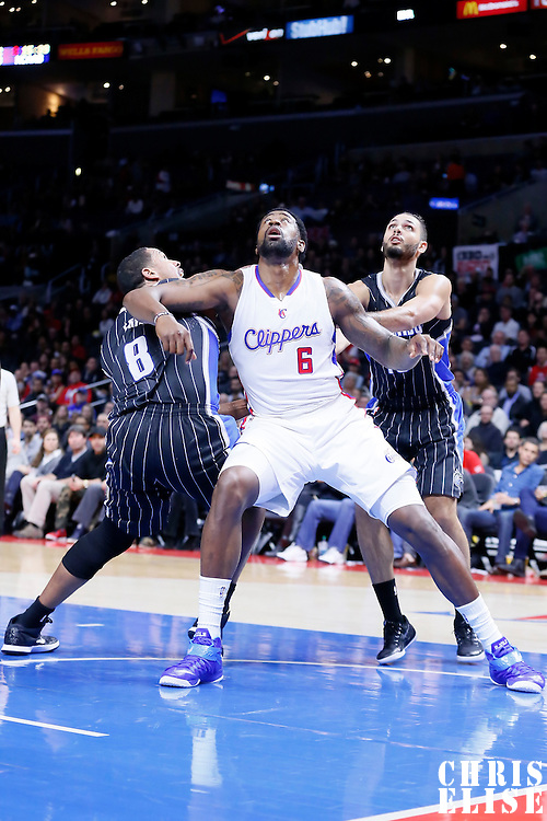 03 December 2014: Los Angeles Clippers center DeAndre Jordan (6) vies for the rebound with Orlando Magic forward Channing Frye (8) and Orlando Magic guard Evan Fournier (10) during the Los Angeles Clippers 114-86 victory over the Orlando Magic, at the Staples Center, Los Angeles, California, USA.
