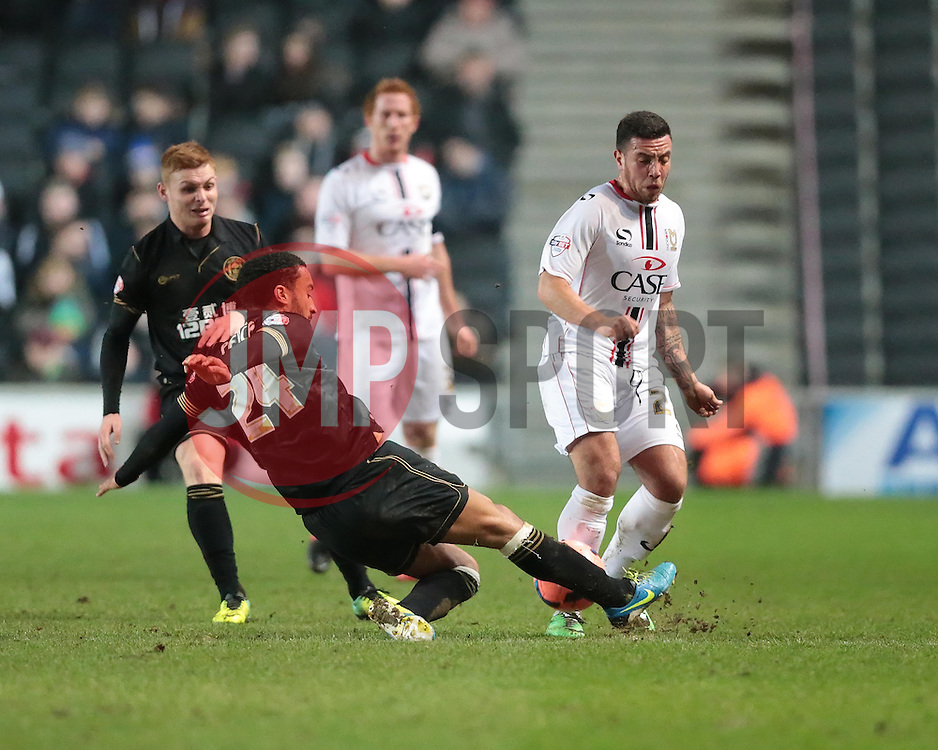 Wigan Athletic's James Perch puts in a tackle - Photo mandatory by-line: Nigel Pitts-Drake/JMP - Tel: Mobile: 07966 386802 14/01/2014 - SPORT - FOOTBALL - Stadium MK - Milton Keynes - MK Dons v Wigan Athletic - FA Cup - Third Round replay