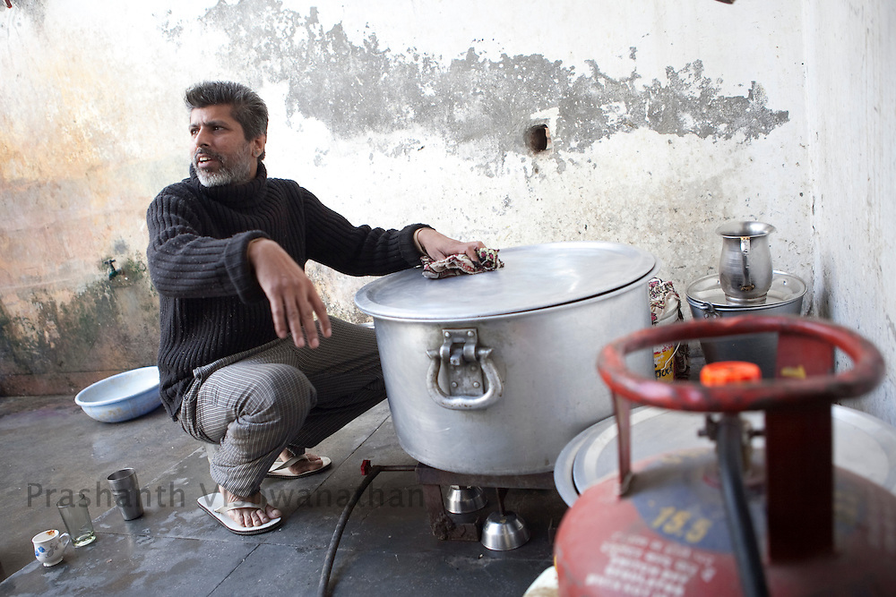 "Rajinder Gill, 42, an  addict works  at the community kitchen at ""Navjeevan"" drug rehabilitation center in Amritsar, India, on Wednesday, December 15, 2010. Photographer: Prashanth Vishwanathan/HELSINGIN SANOMAT"