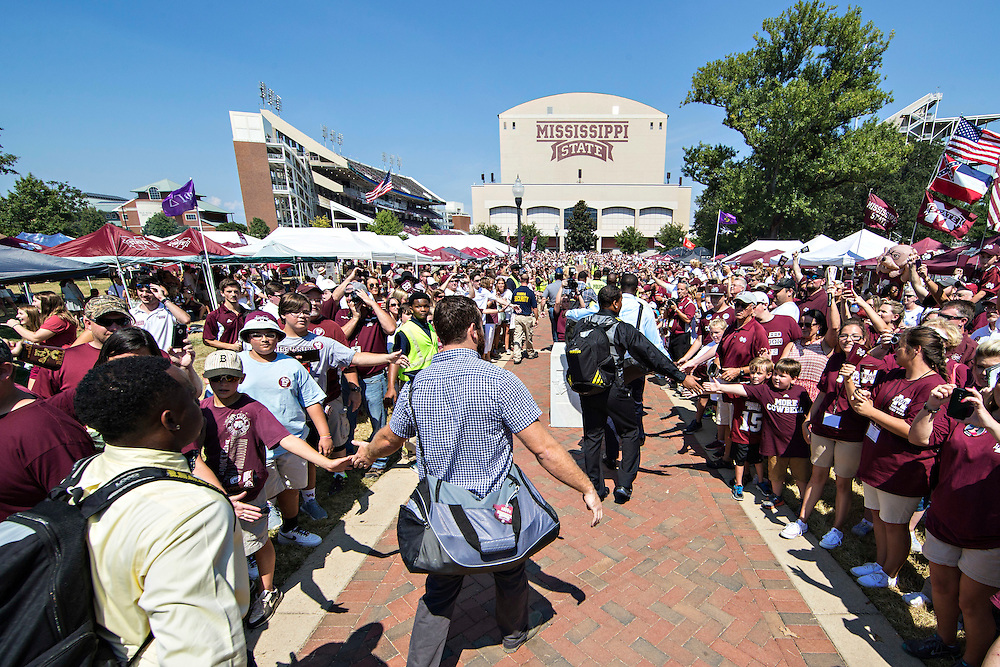 STARKVILLE, MS - SEPTEMBER 19:  Players of the Mississippi State Bulldogs walk through fans on the way to the stadium before a game against the Northwestern State Demons at Davis Wade Stadium on September 19, 2015 in Starkville, Mississippi.  The Bulldogs defeated the Demons 62-13.  (Photo by Wesley Hitt/Getty Images) *** Local Caption ***