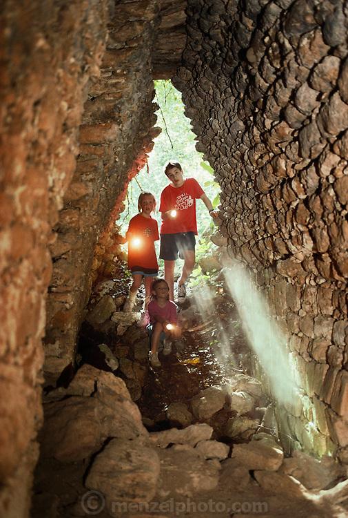 Kids exploring tombs at the Mayan ruins at Becan, Mexico. Jack and Evan Menzel and Sasha Blair.