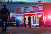 Officers investigate the scene where Antonio Zambrano-Montes was shot and killed by three Pasco Police officers Tuesday at 10th Ave. and W. Lewis St. in Pasco. See a video at www.tricityherald.com