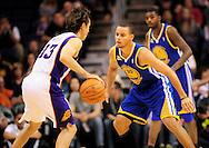 Jan. 2, 2012; Phoenix, AZ, USA; Golden State Warriors guard Stephen Curry (30) guards the Phoenix Suns guard Steve Nash (13) during the US Airways Center. The Suns defeated the Warriors 102-91.  Mandatory Credit: Jennifer Stewart-US PRESSWIRE.