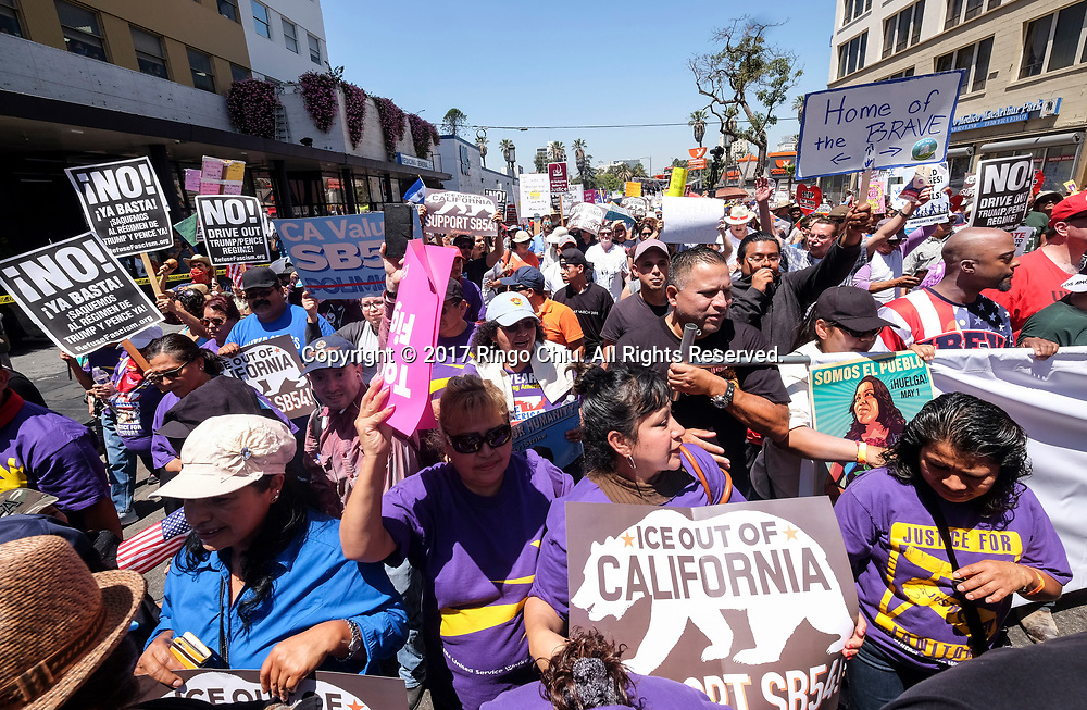 Protesters carry signs marching toward downtown Los Angeles in the annual May Day March in Los Angeles, May 1, 2017. (Photo by Ringo Chiu/PHOTOFORMULA.com)<br /> <br /> Usage Notes: This content is intended for editorial use only. For other uses, additional clearances may be required.
