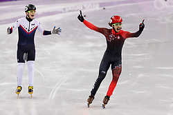 February 17, 2018 - Gangneung, South Korea - Short track skater Samuel Girard of Canada celebrates as he win the gold medal followed by John-Henry Krueger of the United States who wins the silver medal in the Men's Short Track Speed Skating 1000M finals at the PyeongChang 2018 Winter Olympic Games at Gangneung Ice Arena on Saturday February 17, 2018. (Credit Image: © Paul Kitagaki Jr. via ZUMA Wire)