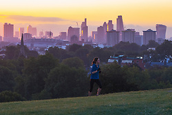Primrose Hill, London, October 4th 2016. The first rays of the sun catch the city's skyscrapers as dawn breaks across London.
