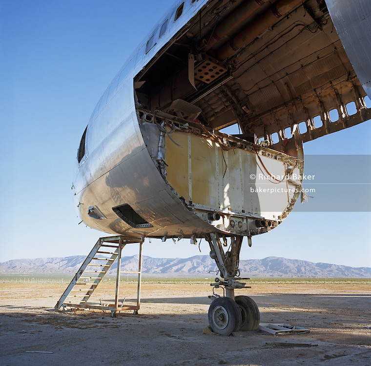 In mid-day heat of the arid Sonoran desert sits the gutted remains of a Lockheed Tri-Star airliner at the storage facility at Mojave, California. Here, the fate of the world?s retired civil airliners is decided by age or a cooling economy and are either cannibalised for still-working parts or recycled for scrap, their aluminium fuselages worth more than their sum total. After a lifetime of safe commercial flight, wings are clipped and cockpits sliced apart by huge guillotines, cutting through the sleek curves. Elsewhere, Jumbo jets, Airbuses and assorted Boeings sit abandoned in the scrub minus their bellies, legs or wings like dying birds. Picture from the 'Plane Pictures' project, a celebration of aviation aesthetics and flying culture, 100 years after the Wright brothers first 12 seconds/120 feet powered flight at Kitty Hawk,1903. .