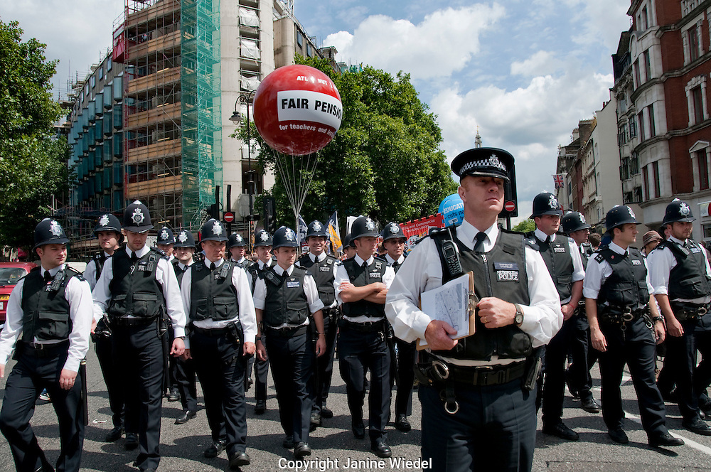 Teachers and Public sector workers march through London in support of widespread strikes againsy cuts and proposed changes to pensions. 30.6.2011