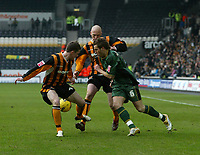 Photo: Andrew Unwin.<br />Hull v Norwich City. Coca Cola Championship. 11/02/2006.<br />Norwich's Darren Huckerby (R) looks to cut inside with the ball.